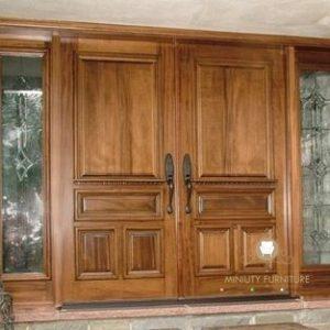 pintu rumah model kupu tarung kayu jati jepara