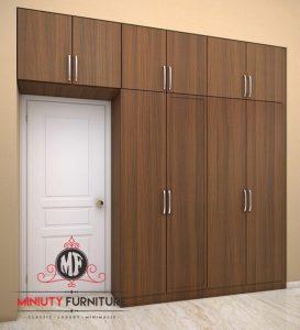wardrobe kamar tidur pintu kamuflase minimalis